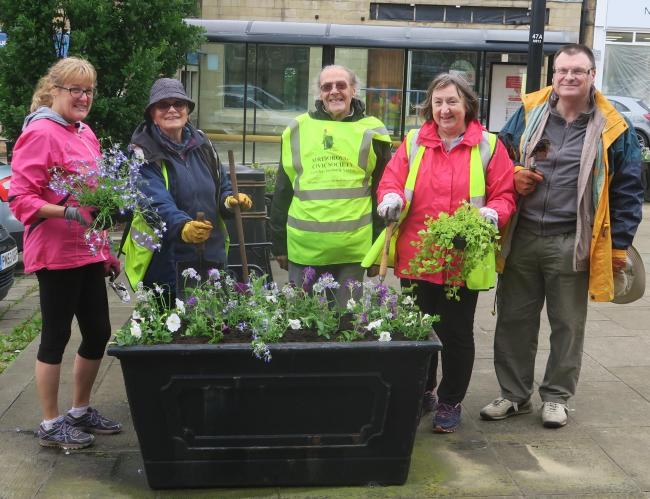 Volunteers have been busy planting flowers around Yeadon town centre