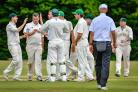 Guiseley players celebrate taking the wicket of Hanzaq Mir. Picture: Andy Garbutt