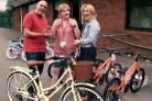Louise Williamson (centre) at Green Meadows School receiving the prize bicycles from Heart Yorkshire presenters Dixie and Emma
