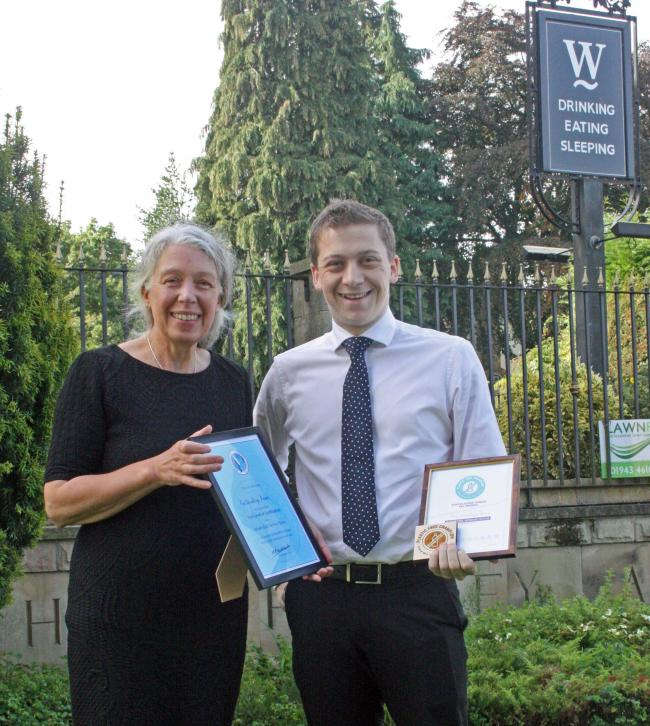 The Wheatley's Jonathan Brown receiving the certificates from Anne Cuthbertson of behalf of WTP. Picture by Louise Miller