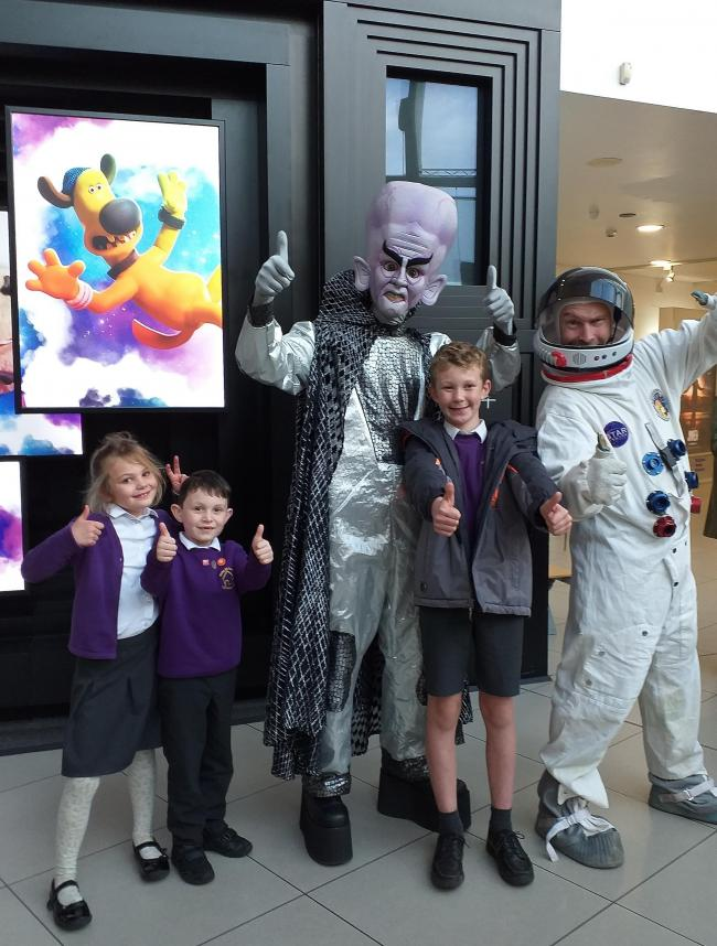 Children arriving for the Space Chase Summer Reading Challenge celebration