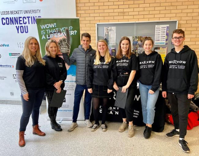 Triathlete Jonny Brownlee (third left) with Leeds Marrow volunteers at Leeds Beckett University