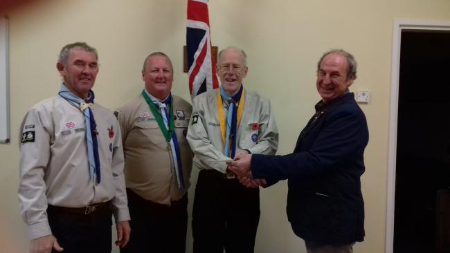 Ian Williamson, Clive Swann and Robin Beaumont from 1st Ben Rhydding Scout Group receiving the donation from Alan Raw of Otley Beer Festival