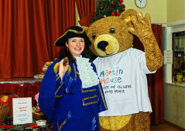 Ilkley Town Crier Isabel Ashman with Marty Bear at the Grand Charity Christmas Fayre
