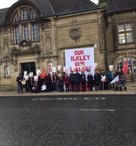 Campaigners fighting cuts to library services form a picket line at Ilkley Library last year