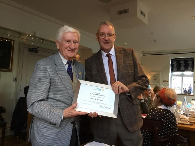 Ilkley Rotary Club member Allan Barnes (left) receiving his award