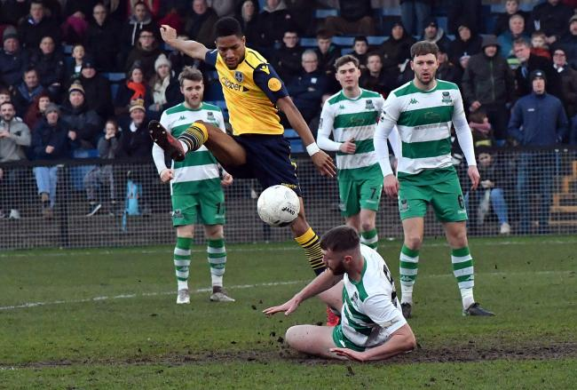 Kaine Felix, centre, was on target for Guiseley