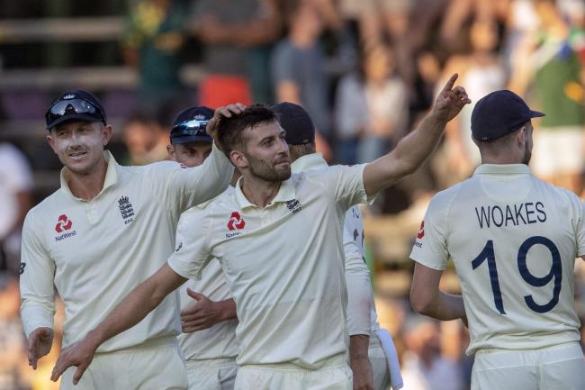 Mark Wood (centre) enjoyed a day to remember in Johannesburg