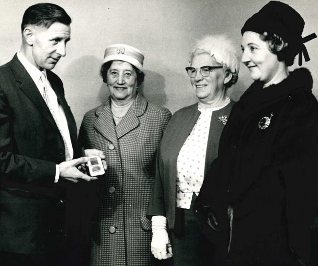 Cyril Blackburn proudly displays his British Empire Medal in this undated photograph from the Wharfedale Observer's archives. Mr Blackburn of Back Lane, Guiseley, was pictured showing the medal to his wife, mother-in-law and another woman. The photo