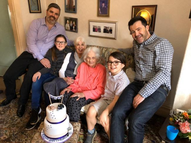 Mary Simpson celebrating her 100th birthday with her family