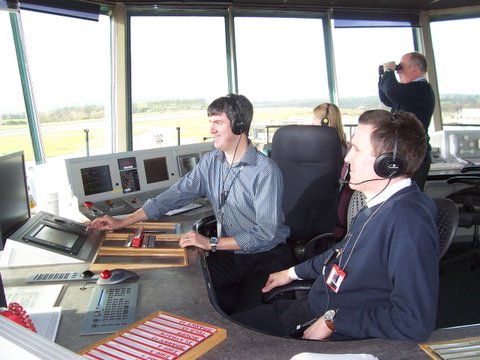 Air traffic controllers keep a close eye on all flights