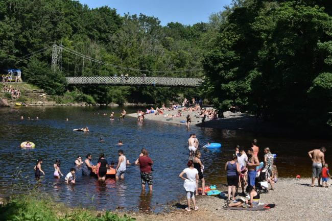 People enjoying the River Wharfe in Ilkley last month