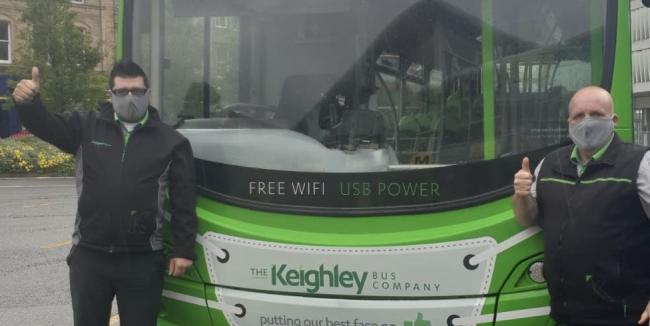 Keighley Bus Company staff demonstrate the face coverings which must be worn by passengers, unless they are exempt