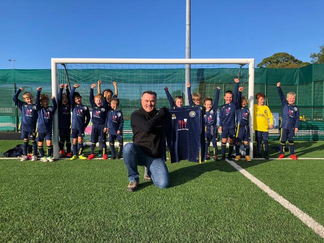 Chef Matt Brown receiving his shirt from the Ilkley Town U8s