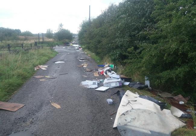 The rubbish strewn road in Yeadon