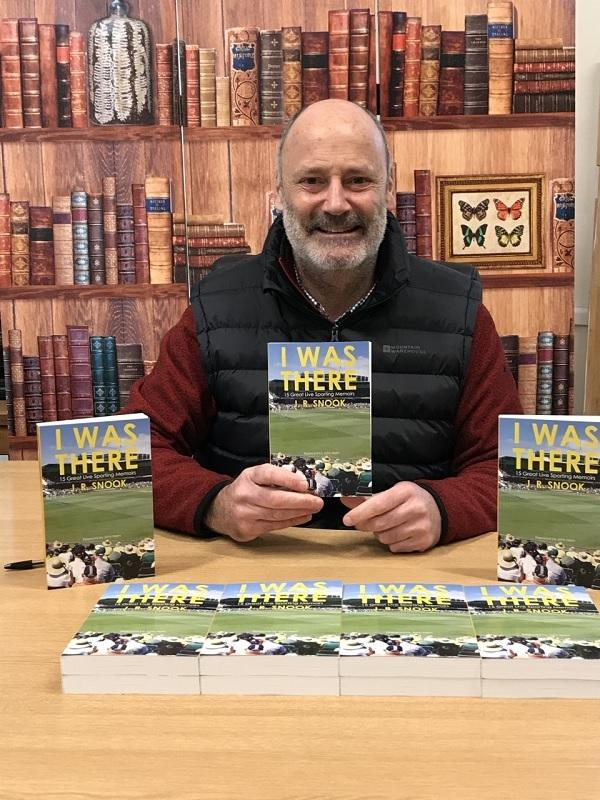 Robin Snook with copies of his new book, taking in 15 momentous live sporting memories of his