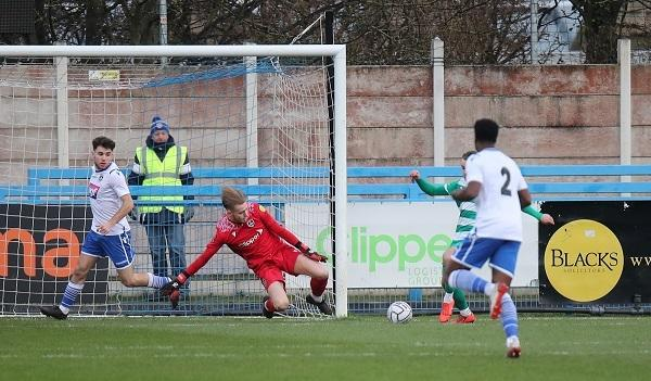 Brad Wade makes a save in Guiseley's draw with Farsley on Boxing Day Picture: Alex Daniel