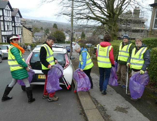 The volunteer litter pickers from the Friends of Ilkley Moor try out their new litter picking equipment