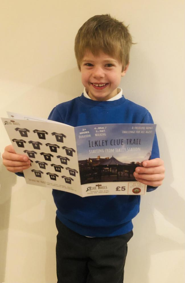Olly, aged seven, is pictured with one of the trails