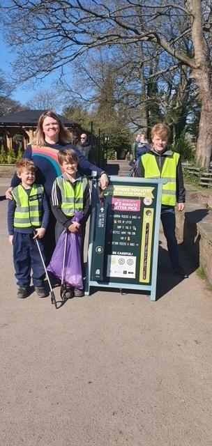 Trash Heroes founder Kate with her sons Finn and Milo, and George, of the FOIRP at launch of the litter station