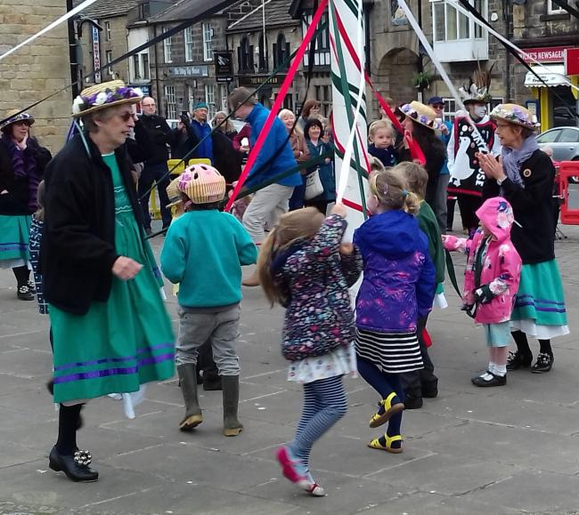 Children enjoying a May Day dance, led by the Buttercross Belles, around Otley Maypole in 2018