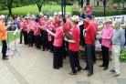 The Moornotes community choir perform On Ilkla Moor Baht 'At at the bandstand on The Grove.
