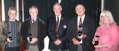 LOYAL SERVANTS: Left to right David Knaggs, Alan Wallace, West Riding County FA president  Peter Marsden, David Martin, and Rachel O'Connor at the presentations.