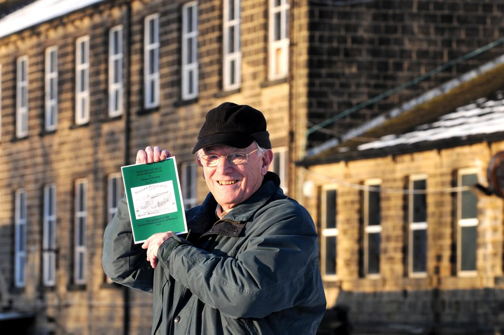 Historian Dennis Warwick at Greenholme Mills with his new book about the pauper apprentices that were brought to work there.
