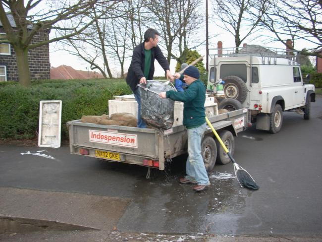 Workmen set about re-stocking Yeadon Tarn after the cold snap led to the death of most of the lake's fish.