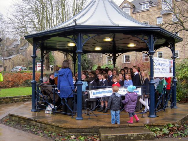 Children singing at the Bandstand.