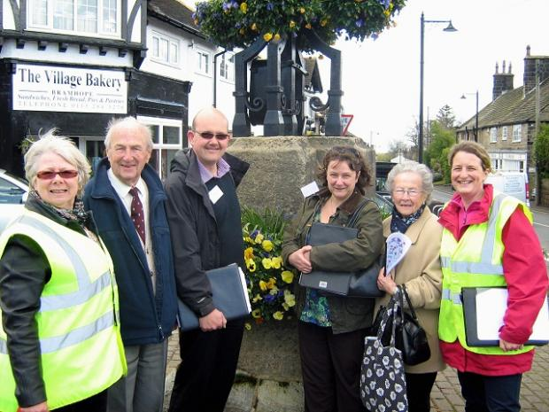 Janet Hobson with Doug Botham, judges Lee Senior and Judith Hales, Corinne Botham and Bramhope in Bloom chairman Kit Hemsley