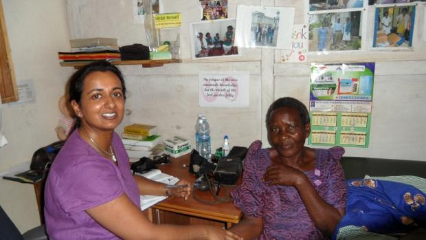 Dr Anita Porter with a patient in the Matugga clinic