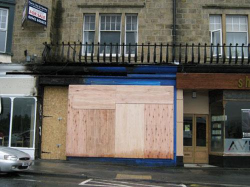 The boarded up Sue Ryder shop