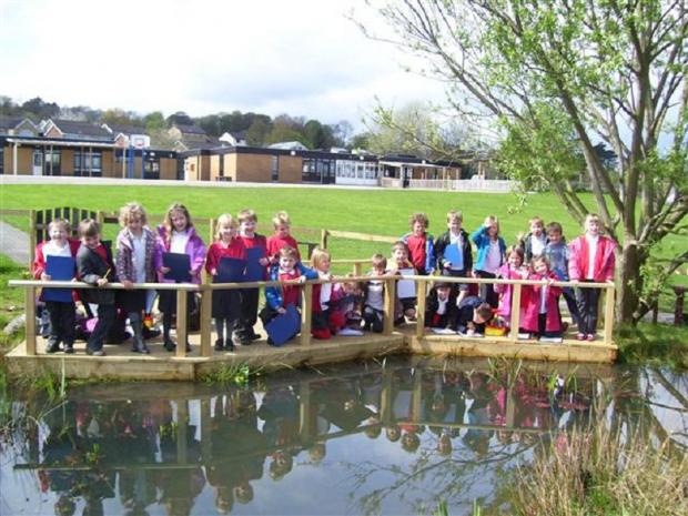 Pupils at the Burley and Woodhead C of E Primary School pond