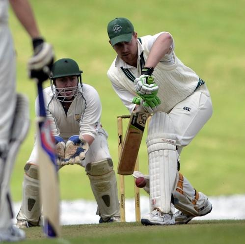 Olicanian batsman Dave Britton defends watchfully during his side's Division Two game at Rawdon