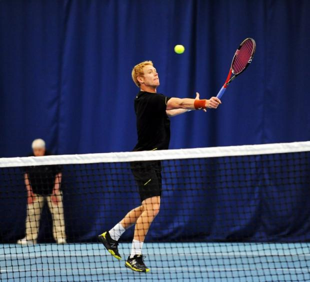 Ilkley singles runner-up Ed Corrie takes to the net in his bid to defeat Josh Goodall