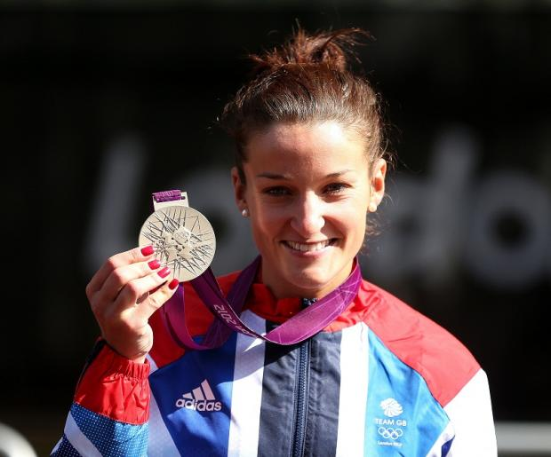 Lizzie Armitstead, left, is all smiles at the medal ceremony after being awarded her silver medal