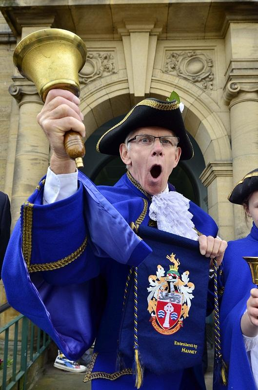 Town crier Chris Richards rings in the Yorkshire Day celebrations in Ilkley