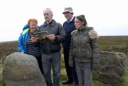 Walkers on the archaeology trail examine the Twelve Apostles stones (Picture by Barry Wilkinson, Friends of Ilkley Moor)