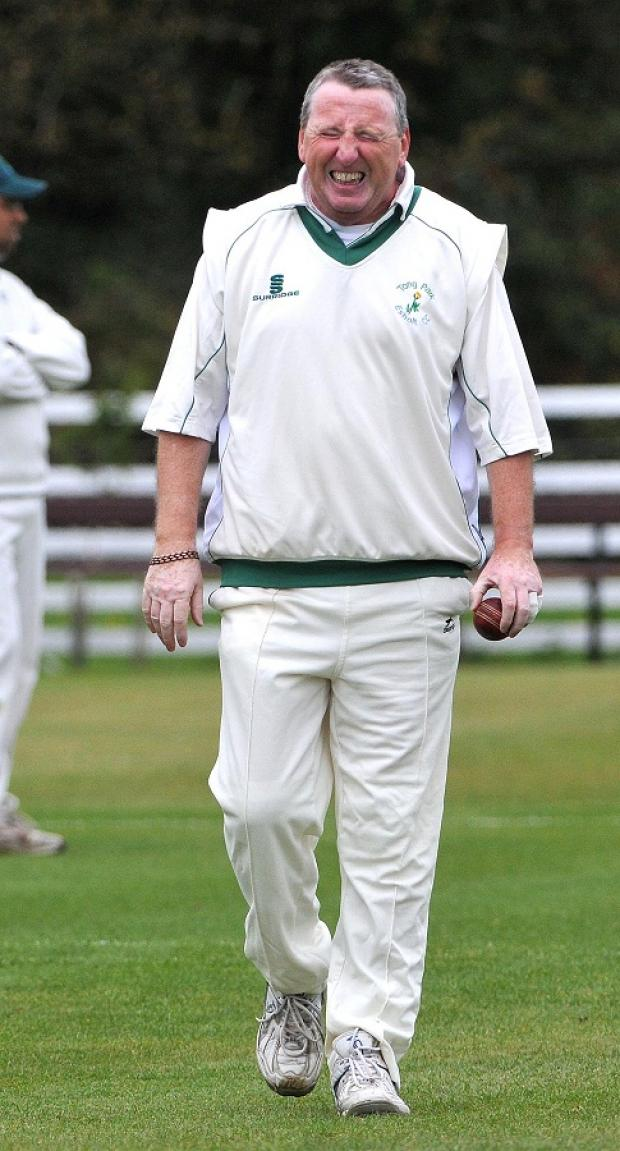 Mick Scott, seen here after pulling a muscle, took his 2,000th wicket in his 4-29 for Tong Park Esholt