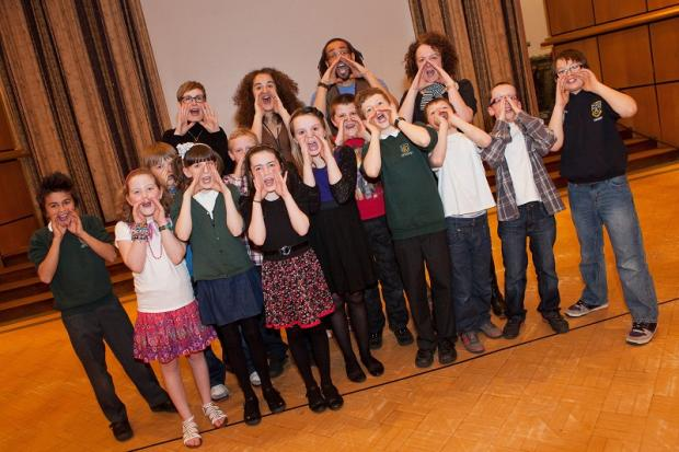 Year Five pupils from Pool-in-Wharfedale Primary School, who won a poetry slam contest organised by The Grammar School at Leeds, with (from left) Sally Fox from Pool Primary, Jenny Webb from the grammar school, poet Simon Murray and Helen Chadwick