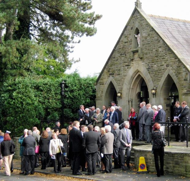 Mourners gather at the funeral service for Jackie Emmott