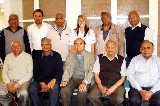 Men from the Anand Milan Centre in Bradford at Westwood Park Community Hospital, with AAA Screening Technician Kirsty Blackburn; Qasim Khan, (second left, back row) organised the screening