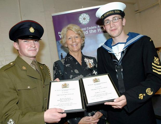 Jake Dowdeswell,left, and Peter Wood being presented with their awards by the Lord-Lieutenant of West Yorkshire, Dr Ingrid Roscoe