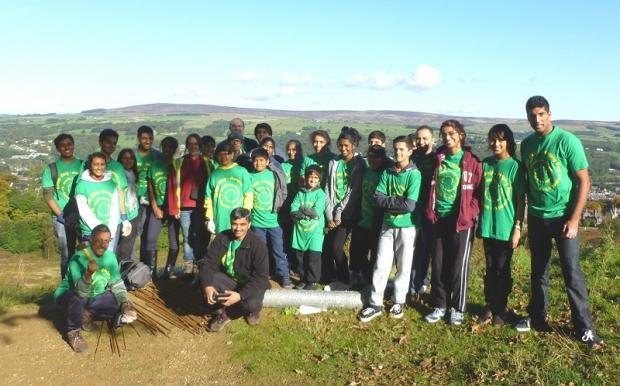 Sewa Day volunteers help build protection areas for trees on Ilkley Moor. Picture by Tracy Gray/Friends of Ilkley Moor