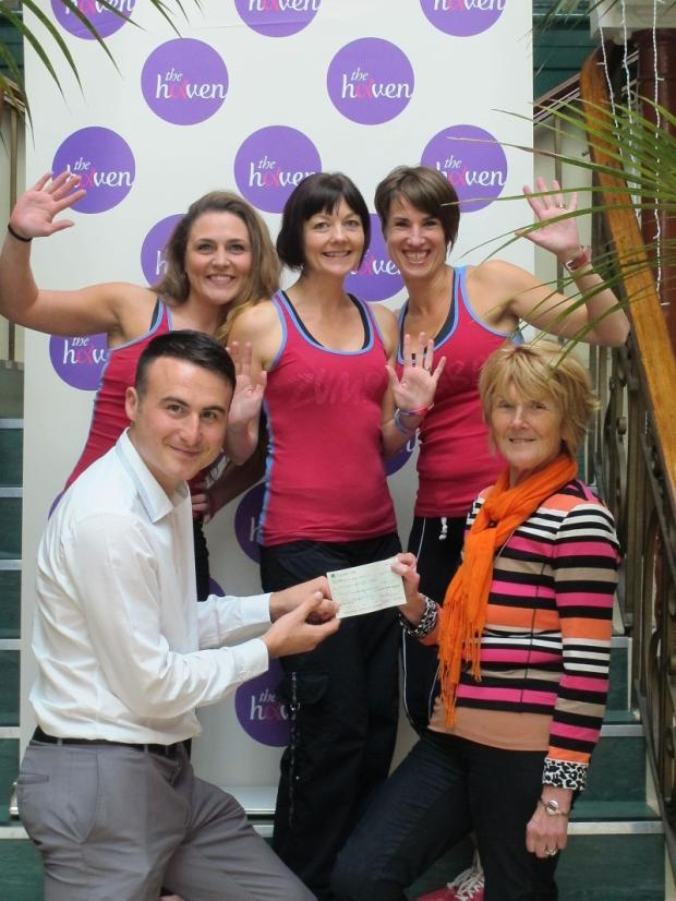 Councillor Anne Hawkesworth presents the money raised at the charity Zumba to Haven fundraiser, Tom Robertshaw, with Zumba instructors Emma Hart, Wendy Houlders and Elyse Shankland