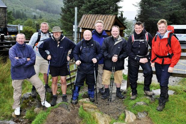 Charity walkers John Waite, Paul Mackie, Richard Waters, Craig McHugh, Martin Sweeney, Russell McGrath, Martin Ribchester and Chris Schofield