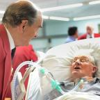 Ilkley Gazette: Gordon Sugden in conversation with one of his fellow Steeton Male Voice Choir members during the special concert at the Northern General Hospital in Sheffield, where he is being treated after a tragic car accident left him paralysed