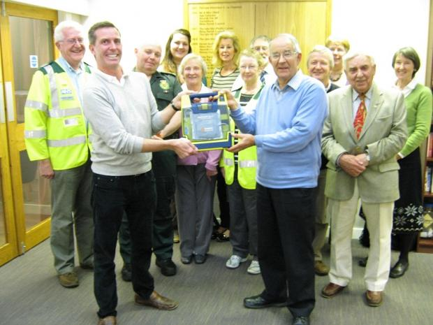 Presentation of a defibrillator machine to the Clarke Foley Centre in Ilkley, which was used a day later to save a man's life