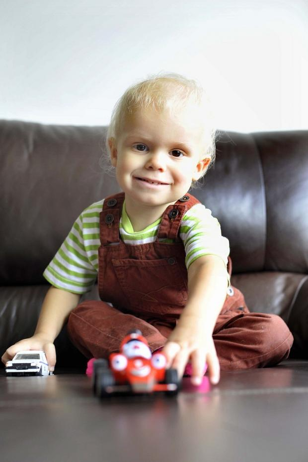 Two year-old Edward Clarke, from Guiseley, who suffers from leukaemia, pictured at home playing with his toys